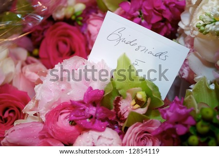 Wedding flowers in a church bridesmaids bouquetes - stock photo
