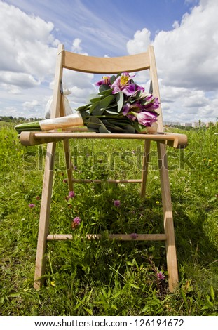 wedding flowers on the chair in the field
