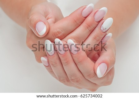 Wedding French manicure with crystals on long oval nails