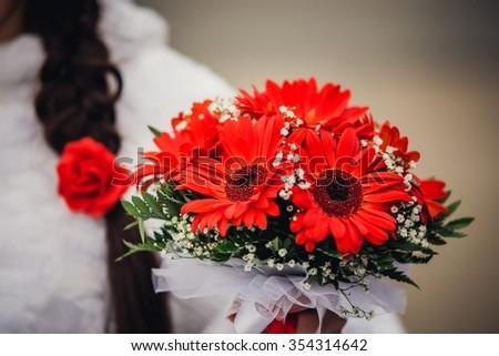 wedding gerbers bouquet, couple in bokeh, beautiful gerbera flower blooming - stock photo