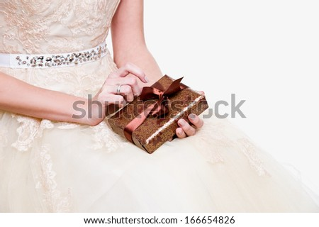 Wedding. Gift boxes in bride hands - stock photo