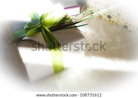 Wedding gift with green bow and sunlight - stock photo