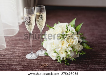 Wedding glasses and bouquet - stock photo