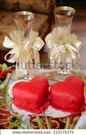 Wedding glasses and love hearts - stock photo