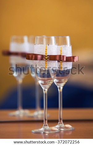 wedding glasses decorated with a brown bow