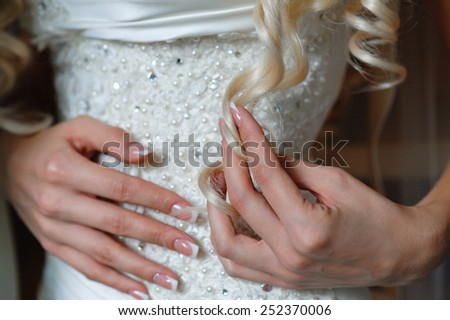 Wedding gloves on hands of bride, close-up. - stock photo