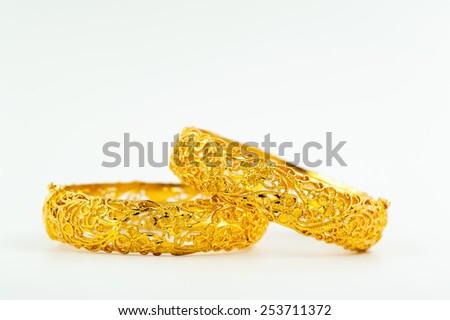 Wedding gold bracelets for Thai bride - stock photo