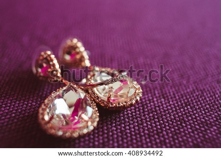 wedding gold earring for a beautiful bride - stock photo