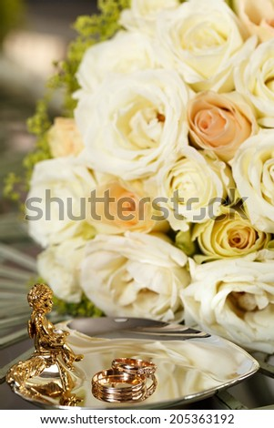 Wedding gold rings bride and groom. - stock photo