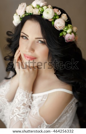 Wedding hairstyle and makeup, beautiful young bride with flowers wreath at marriage morning, happy caucasian girl bridal look.