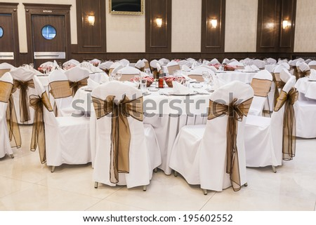 Wedding hall interior set for fine dining  - stock photo