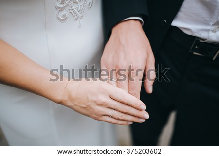 Wedding. Hands of the groom and the bride with wedding rings - stock photo