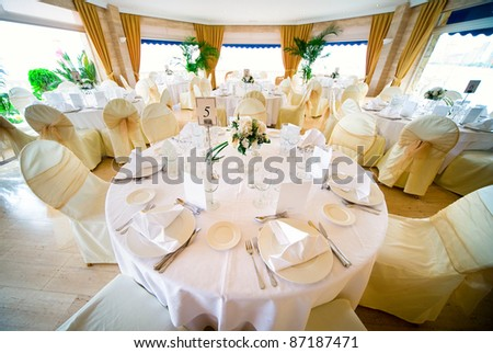 Wedding interior with table and chairs - stock photo