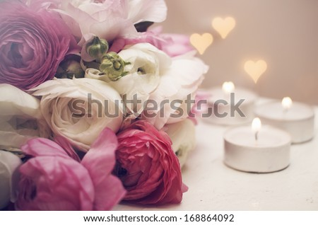 Wedding invitation. Flowers with candles and romantic light - stock photo