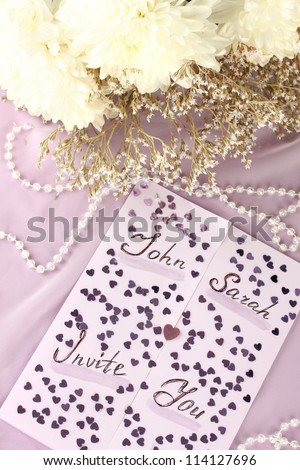 wedding invitations on decorated table close-up - stock photo