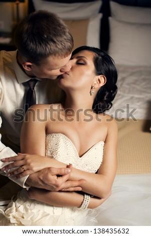 wedding kiss on their wedding night - stock photo