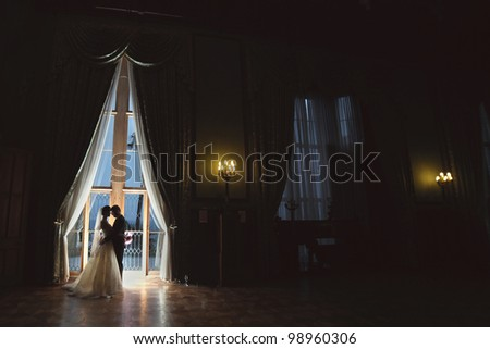 wedding kiss on their wedding night at the Palace - stock photo