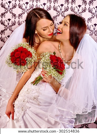 Wedding lesbians girl in bridal dress at home - stock photo
