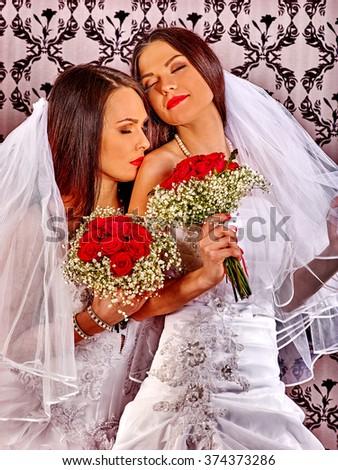 Wedding lesbians girl in bridal dress posing at camera. - stock photo