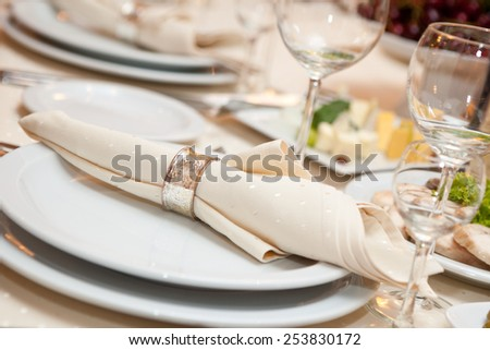 wedding napkin decoration. table appointments closeup - stock photo