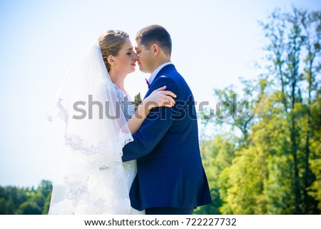 Wedding on a warm, sunny day in a beautiful European park. The groom is younger than the bride.Plus size woman- bride . A nice and beautiful couple have a happy day