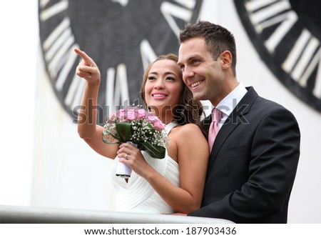 Wedding on the nature, young wedding couple showing - stock photo