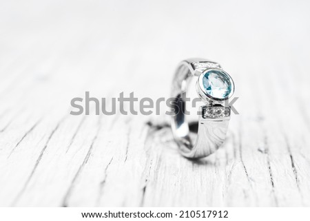 Wedding or Engagement Ring with Blue Diamonds - stock photo
