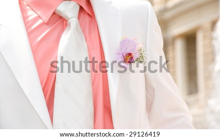 Wedding orchid on lapel of male