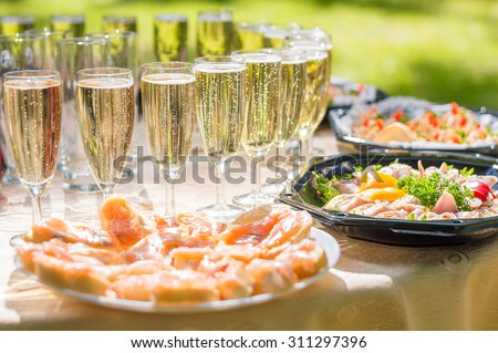Wedding party buffet with champagne, canape, sandwiches - stock photo