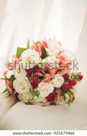 Wedding perfect bridal bouquet of different flowers