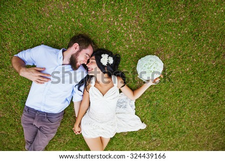 wedding photo of couple on a grass