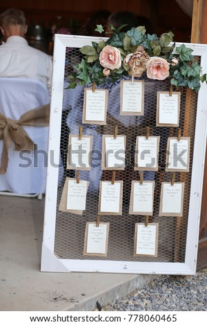 Elegant Wedding Photography: Rustic Seating Chart With Floral Decoration On A White  Wooden Frame