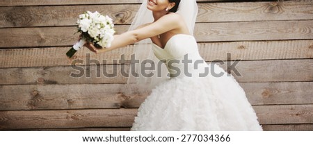 Wedding picture of happy bride against wooden background.  - stock photo