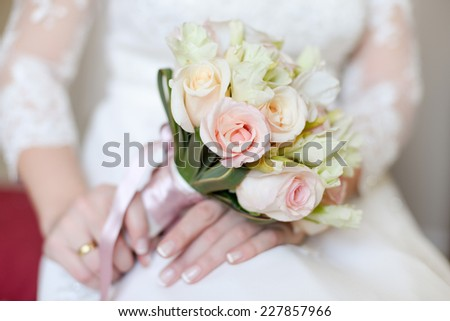 wedding pictures with details of flowers, dress lace details, hands and wedding rings - stock photo