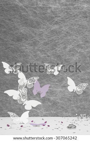 Wedding Place Card butterfly's on a White tablecloth with ribbons,bows,silver heart confetti and diamond table decorations - stock photo