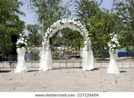 wedding place decoration with artificial flowers - stock photo