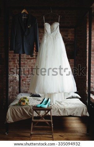 Wedding preparation, dress and suit - stock photo
