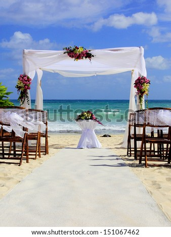 Wedding preparation on Mexican beach against a background of beautiful sea and blue sky - stock photo