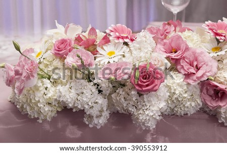 Wedding reception detail. fresh flower decoration. Rose color accent. - stock photo