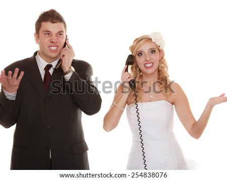 Wedding relationship difficulties. Angry woman and fury man talking on phone. Couple bride groom quarrelling screaming isolated on white. - stock photo