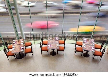 Wedding restaurant table set awaiting guests and food - stock photo