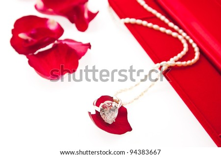 wedding ring and pearl necklace with red box