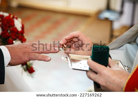 Wedding ring ceremony. - stock photo