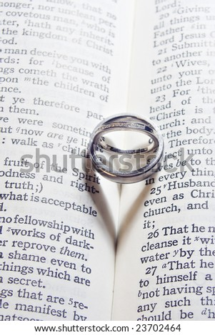 Wedding Ring Heart Shadows - stock photo