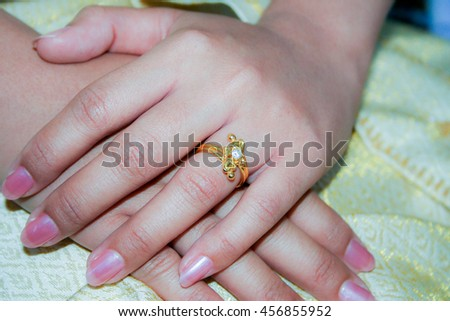 wedding ring in bride hands