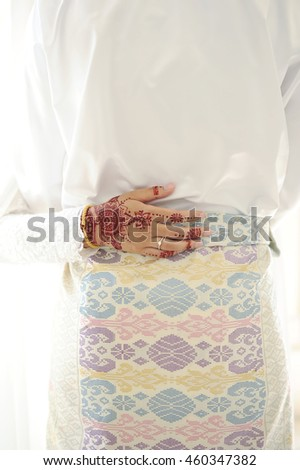 Wedding ring with henna in hand