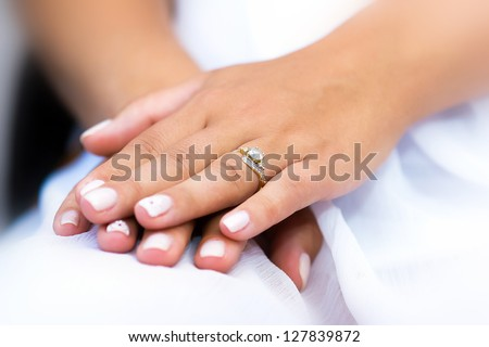 Wedding ring with stone on bride hand - stock photo