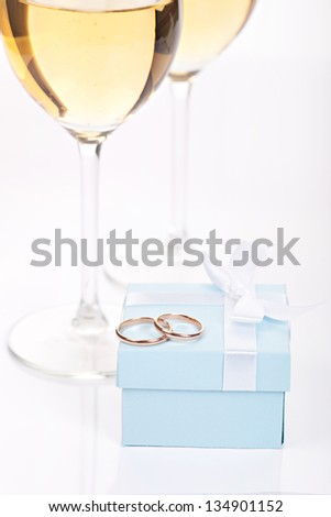 Wedding rings and glasses of champagne - stock photo