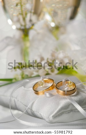 Wedding rings and glasses with a champagne - stock photo