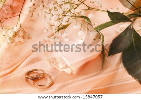 Wedding rings and rose collage - stock photo